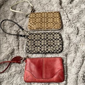 Three Coach wristlets